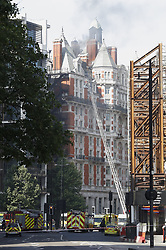 © Licensed to London News Pictures. 06/06/2018. London, UK. Emergency services at the Mandarin Oriental hotel during a fire. Fifteen fire engines and 97 firefighters and officers have been called to a fire believed to be at the Mandarin Hotel in Kightsbridge. Photo credit: Peter Macdiarmid/LNP