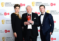 Sir David Attenborough (centre) with the award for Virgin TV's Must-see moment alongside Emma Willis and Dremot O'Leary in the press room at the Virgin TV British Academy Television Awards 2018 held at the Royal Festival Hall, Southbank Centre, London.