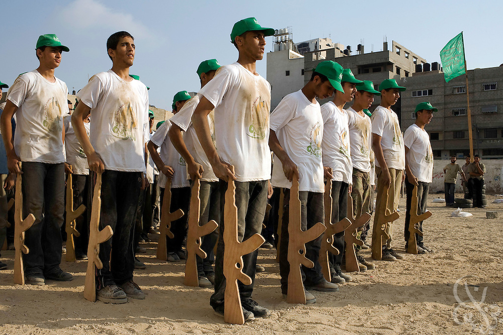 Palestinian boys receive military style training during one of the numerous free Hamas sponsored summer camp programs August 01, 2007 in Gaza City, Gaza. Hamas cements much of its' popularity by sponsoring community activities such as free summer camps for kids, mass weddings,  trash pickups and food distributions across Gaza.