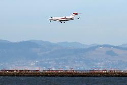 Cessna 750 Citation X (N92RX) landing at San Francisco International Airport (KSFO), San Francisco, California, United States of America