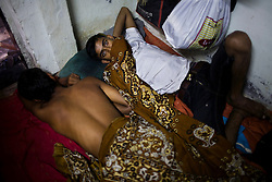 Brothers Vishnu Gaikwad(right) and Samadhan Amravati(left), both have TB and live together in this small cramped room.  They both feel very sick and spend a large portion of the day sleeping.