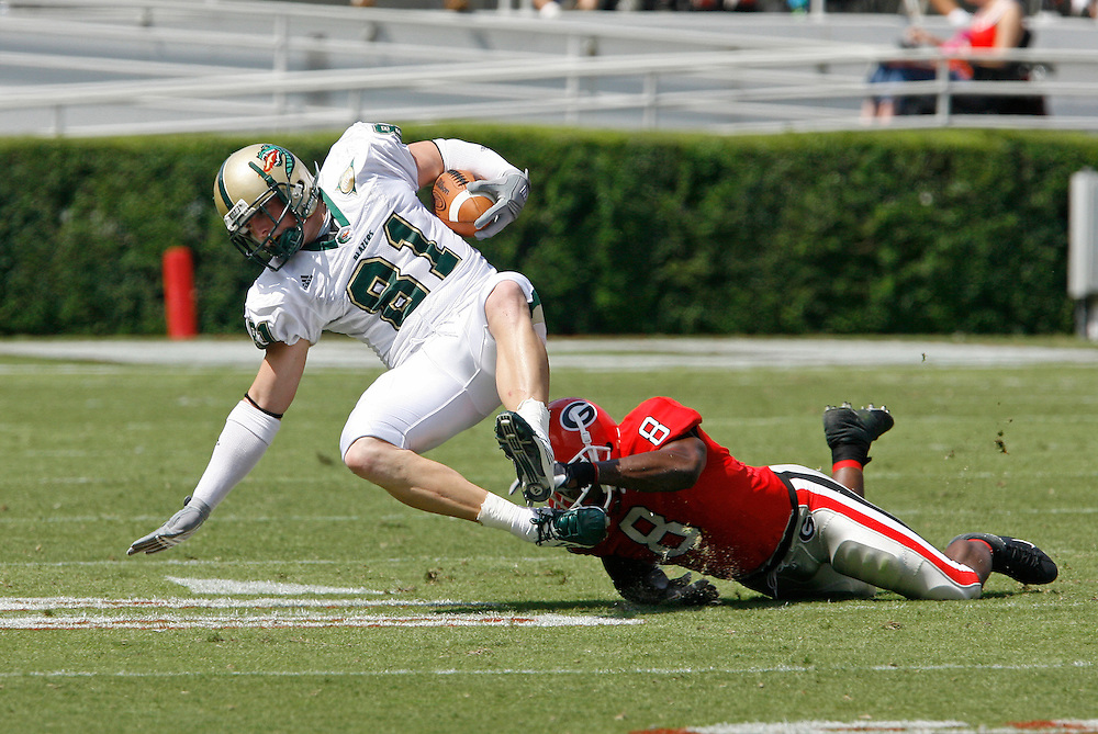 Georgia WC Paul Oliver trips up UAB TE Jordan Erwin during the game between the University of Georgia Bulldogs and University of Alabama-Birmingham (UAB) Blazers at Sanford Stadium in Athens, GA on September 16, 2006.