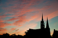 Our Lady of Chartres Cathedral, Chartres, France. The silhouette of the cathedral against the rosy dawn sky.