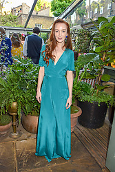 Olivia Grant at The Ivy Chelsea Garden Summer Party ,The Ivy Chelsea Garden, King's Road, London, England. 14 May 2019. <br /> <br /> ***For fees please contact us prior to publication***
