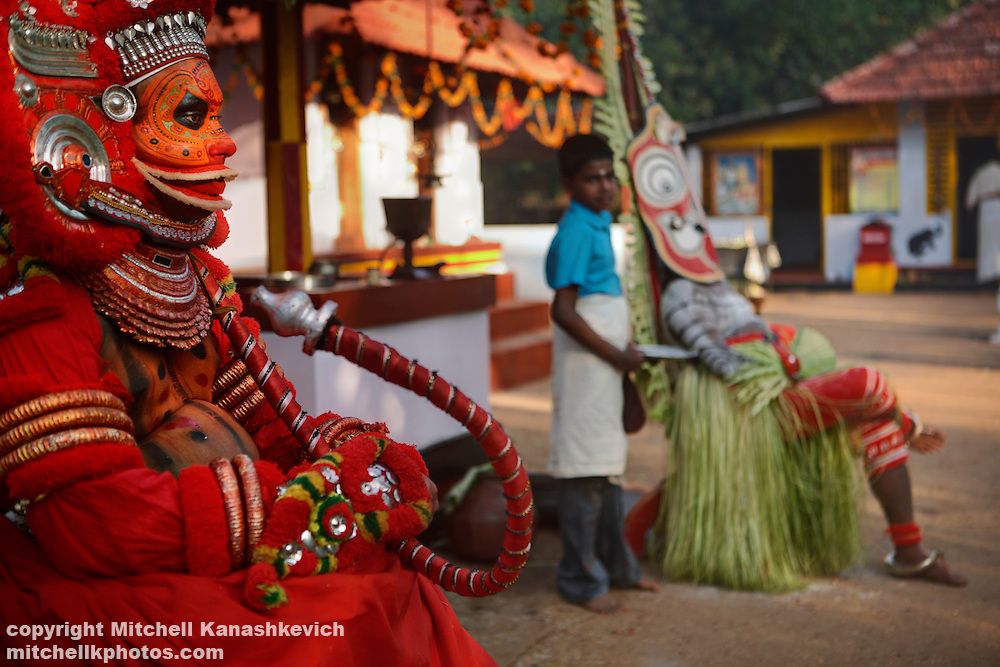 Before a Theyyam performance, Kannur District, Kerala, India. .It is believed that while performing; the artist is possessed by a divine spirit and becomes a God - or Theyyam in the local language. In Hinduism there are literally millions of Gods; both good and evil and The four hundred existing variations of Theyyam performances are dedicated to just some of them.