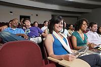 Female student sitting in class, portrait
