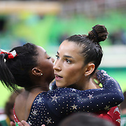 Gymnastics - Olympics: Day 2  Alexandra Raisman #395 of the United States is congratulated by teammate Simone Biles #391 of the United States after performing her routine on the Balance Beam during the Artistic Gymnastics Women's Team Qualification round at the Rio Olympic Arena on August 7, 2016 in Rio de Janeiro, Brazil. (Photo by Tim Clayton/Corbis via Getty Images)