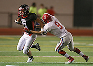 Linn-Mar's Matt Meier (7) tries to pull away from Washington's Kyle Malcolm (9) during the second quarter of the game between Cedar Rapids Washington and Linn-Mar at Linn-Mar Stadium in Marion on Friday, September 14, 2012.