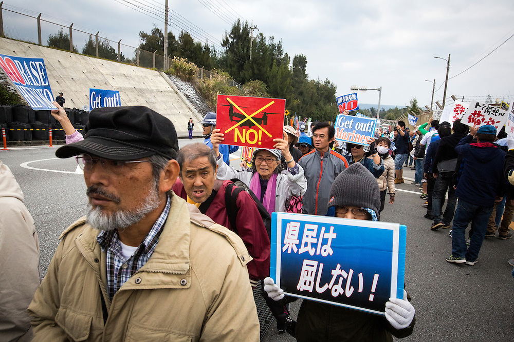 OKINAWA, JAPAN - FEBRUARY 1 : Anti U.S. Base protesters with placards stage a rally outside of the U.S Marine Camp Schwab gate to protest against the construction of the new U.S Marine Airbase in Nago, Okinawa, Japan on Wednesday, February 1, 2017. Okinawa Gov. Takeshi Onaga arrived in the United States on Tuesday, aiming to convey to President Donald Trump's administration local opposition to a plan to relocate a U.S. airbase within the southern island prefecture. (Photo by Richard Atrero de Guzman/NURPhoto)