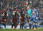 Norwich City Steven Whittaker is shown the yellow card by Referee Andy Davies during the Sky Bet Championship match between Brighton and Hove Albion and Norwich City at the American Express Community Stadium, Brighton and Hove, England on 3 April 2015. Photo by Phil Duncan.