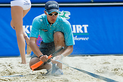 Referee assistant cleaning the border line at A1 Beach Volleyball Grand Slam tournament of Swatch FIVB World Tour 2010, on July 31, 2010 in Klagenfurt, Austria. (Photo by Matic Klansek Velej / Sportida)