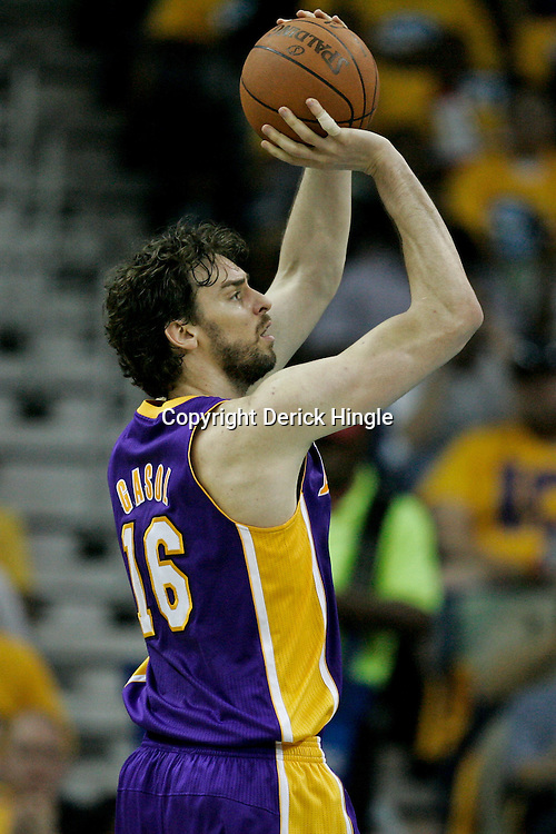 April 22, 2011; New Orleans, LA, USA; Los Angeles Lakers power forward Pau Gasol (16) shoots against the New Orleans Hornets during the first half in game three of the first round of the 2011 NBA playoffs at the New Orleans Arena. The Lakers defeated the Hornets 100-86.   Mandatory Credit: Derick E. Hingle