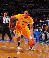 California guard Jorge Gutierrez #2 drives to the basket against Syracuse during the 2K Sports Classic in Madison Square Garden.