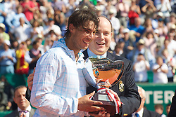 MONTE-CARLO, MONACO - Sunday, April 18, 2010: Prince Albert II, Sovereign Prince of Monaco, presents Rafael Nadal (ESP) with the trophy following his 6-0, 6-1 Men's Singles Final victory on day seven of the ATP Masters Series Monte-Carlo at the Monte-Carlo Country Club. (Photo by David Rawcliffe/Propaganda)