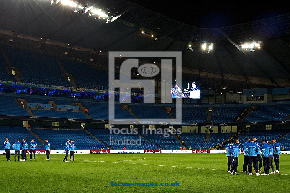 Picture by Ian Wadkins/Focus Images Ltd +44 7877 568959<br /> 15/01/2014<br /> General view of the stadium showing Blackburn Rovers players inspecting the pitch ahead of the The FA Cup match at the Etihad Stadium, Manchester.