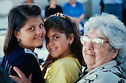 Lisvori. Annual festival of a local Greek Orthodox Chapel. Grandmother and granddaughters.