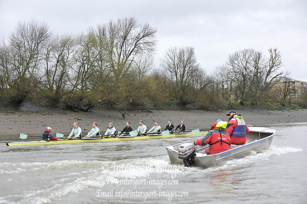 Putney, London,  Cambridge UBC, Bow - Rob WEITEMEYER, 2 - Geoff ROTH, 3 - George NASH, 4 - Peter McCELLAND, 5 - Deaglan McEACHERN, 6 - Henry PELLY, 7 - Derek RASMUSSEN, Stroke - Fred GILL, Cox - Ted RANDOLPH coaches launch Chris NILSSON and Donald LEGGETT,  CUBC Training session on the River Thames during Varsity, University Boat Race, Tideway Week, Tuesday  30/03/2010 [Mandatory Credit Peter Spurrier/ Intersport Images]