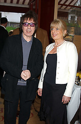 BILL WYMAN and GILL CATTO at a private view of paintings by singer Tony Bennett held at the catto Gallery, 100 Heath Street, London NW3 on 5th April 2005.<br /><br />NON EXCLUSIVE - WORLD RIGHTS