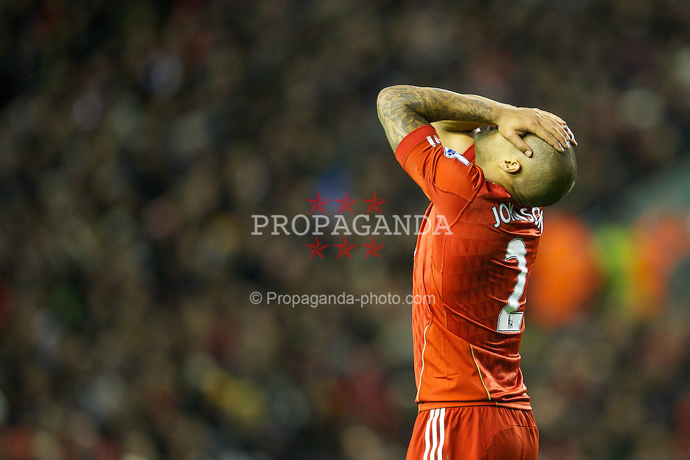 LIVERPOOL, ENGLAND - Saturday, December 10, 2011: Liverpool's Glen Johnson looks dejected during the Premiership match against Queens Park Rangers at Anfield. (Pic by David Rawcliffe/Propaganda)