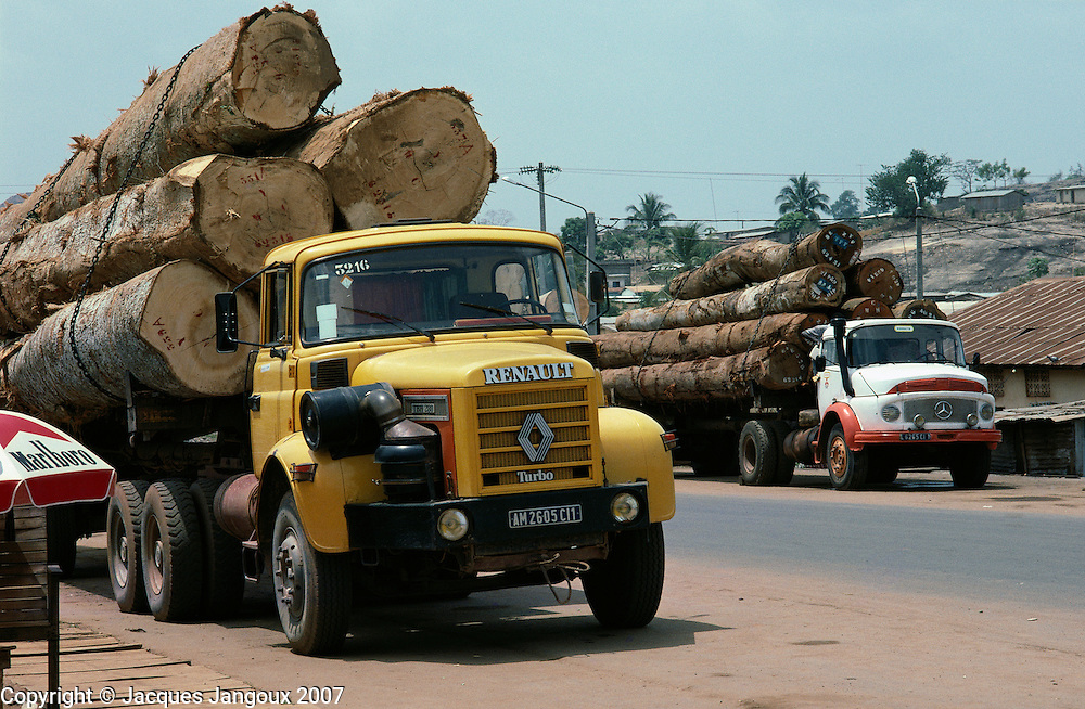 Deforestation: trucks loaded with logs in western Ivory Coast, Africa.