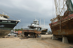 Ships resting in dry dock being repaired and repainted in Louisiana in the United States