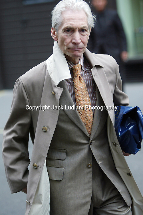 CHARLIE WATTS PICTURED DOING SOME LIGHT SHOPPING