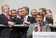 Maiaufmarsch (Labour Day March) of the SPOE (Social Democratic Party of Austria). Leading SPOE politicians holding speeches at the Rathaus (City Hall), here Union Leader Erich Voglar. Behind: Viennese Mayor Michael Haeupl (l.) and Chancellor Werner Faymann (m., striped tie).