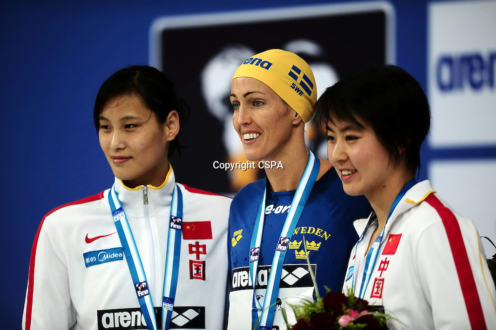 Nov 08, 2011; Beijing, CHINA; (L-R) Lu Ying of China, Therese Alshammar of Sweden and Jiao Liuyang of China get silver, gold and bronze medal in the final of Women's 100m Butterfly during day one of the FINA/ARENA Swimming World Cup 2011 at the National Aquatics Center.