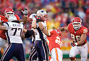 Kansas City Chiefs safety Sammy Knight hits New England Patriots quarterback Tom Brady's arm while trying to throw a pass during a 26 to 16 win over the New England Patriots on November 27, 2005 at Arrowhead Stadium in Kansas City, Missouri.