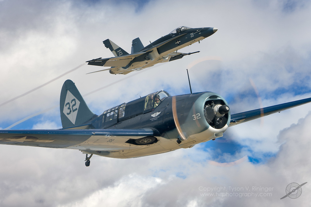 "To commemorate the 100th Anniversary of Naval Aviation, an F/A-18C Hornet takes on the colors of a WWII Helldiver unit and joins the world's only airworthy Helldiver in the skies above Central California. The F/A-18C is flown by VFA-122's LT Alex ""Scribe"" Armatas and the Helldiver is piloted by Mark Allen."