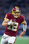 ARLINGTON, TX - NOVEMBER 22:  Colt McCoy #12 of the Washington Redskins runs the ball during a game against the Dallas Cowboys at AT&T Stadium on November 22, 2018 in Arlington, Texas.  The Cowboys defeated the Redskins 31-23.  (Photo by Wesley Hitt/Getty Images) *** Local Caption *** Colt McCoy