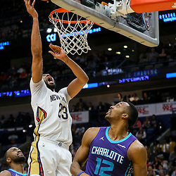 Mar 13, 2018; New Orleans, LA, USA; New Orleans Pelicans forward Anthony Davis (23) shoots over Charlotte Hornets center Dwight Howard (12) during the fourth quarter of a game at the Smoothie King Center. The Pelicans defeated the Hornets 119-115.  Mandatory Credit: Derick E. Hingle-USA TODAY Sports