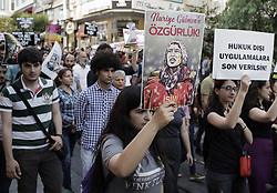 June 16, 2017 - Istanbul, Turkey - People hold placards during a protest in support of sacked academic Nuriye Gulmen and primary school teacher Semih Ozakca, who were arrested by a court decision on the 76th day of their hunger strike, in Istanbul, Turkey on June 16, 2017. (Credit Image: © Erhan Demirtas/NurPhoto via ZUMA Press)