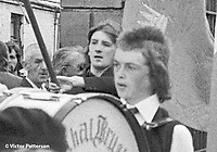 Bobby Sands, aka Robert Gerard Sands, a member of the Provisional IRA, who died 5th May 1981 on hunger strike at HM Prison Maze, near Lisburn, N Ireland while imprisoned for firearms possession. This photo was taken during a parade in Belfast marking the fifth anniversary of Internment on 8th August 1976. He is seen holding flagpole of an Irish Tricolour. Taken exiting Belfast City Cemetery. 19760808059BS1<br /><br />Copyright Image from Victor Patterson, Belfast, UK<br /><br />t: +44 28 9066 1296 (from Rep of Ireland 048 9066 1296)<br />m: +44 7802 353836<br /><br />victorpattersonbelfast@gmail.com<br />www.victorpatterson.com<br /><br />Please see my Terms and Conditions of Use at https://www.victorpatterson.com/page2<br />It is IMPORTANT that you familiarise yourself with them.<br /><br />Images used online incur an additional cost and must be visibly watermarked i.e. © Victor Patterson within the body of the image and copyright metadata must not be deleted. Images used on the Internet have a size restriction of 4kbs and are chargeable at rates available at victorpatterson.com.<br /><br />This image is only available for the use of the download recipient i.e. television station, newspaper, magazine, book publisher, etc, and must not be passed on to any third party. It is also downloaded on condition that each and every subsequent usage is notified within 7 days to victorpattersonbelfast@gmail.com<br /><br />The right of Victor Patterson to be identified as the author is asserted in accordance with The Copyright Designs And Patents Act (1988). All moral rights are asserted.
