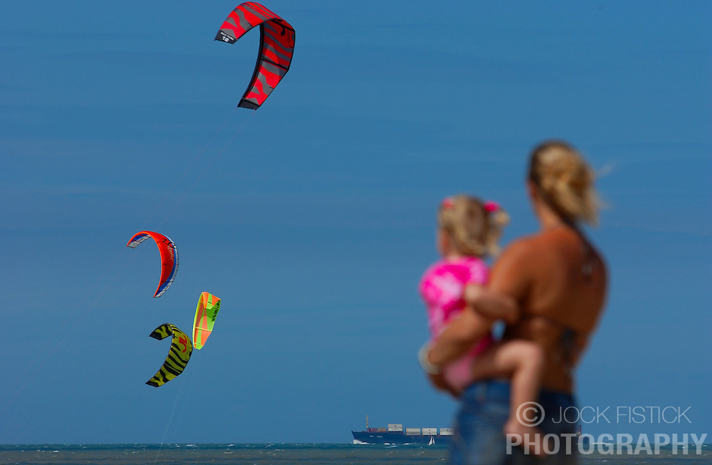 KNOKKE, BELGIUM - JULY-30-2005 - Sailboard kites fill the sky over the North Sea resort town of Knokke. (Photo © Jock Fistick)