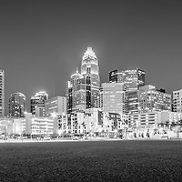 Charlotte skyline at night black and white panorama photo with Romare Bearden Park and downtown Charlotte buildings. Charlotte is a major city in North Carolina in the Eastern United States.
