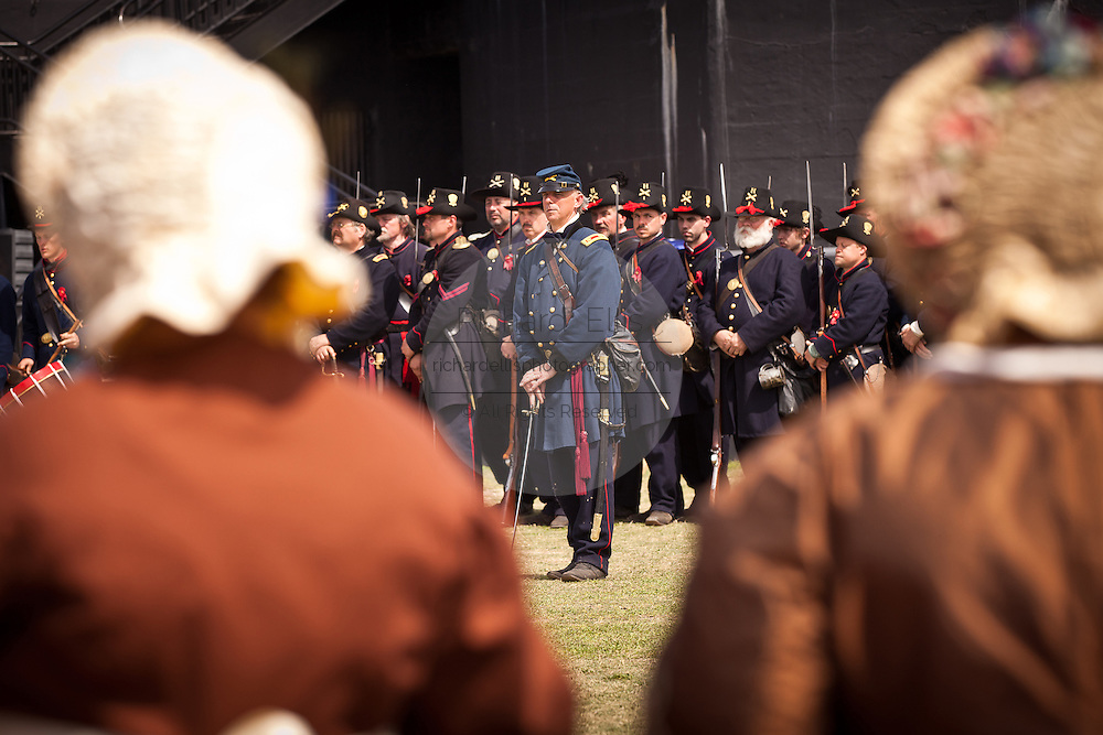 A re-enactor portraying Union officer Maj. Robert Anderson surrenders his command during an event marking the 150th anniversary of the surrender of the fort in the US Civil War on April 14, 2011 in Charleston, South Carolina.  The surrender of the fort marks the end of a week long commemoration of the start of the Civil War.