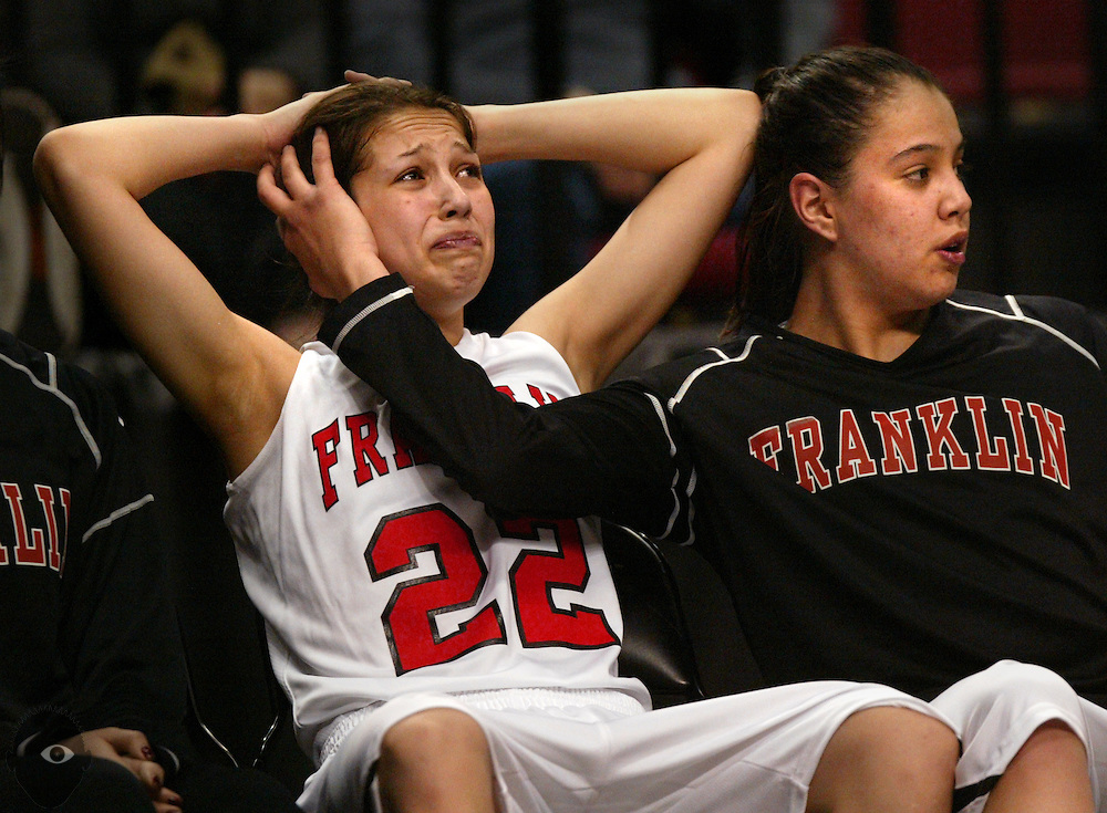 03/10/2010 - Franklin's Jude Schimmel (22) is consoled on the bench by her older sister Shoni Schimmel (23) as the game winds down and both have fouled out. Jesuit beat Franklin 83-70 in the 2010 OSAA 6A Girls Basketball State Playoffs from the Rose Garden.