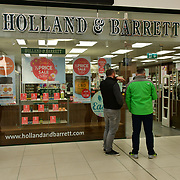 During the coronavirus in UK lockdown seen people queue outside Holland & Barrett, at Walthamstow Shopping mall,on 28 March 2020 London.