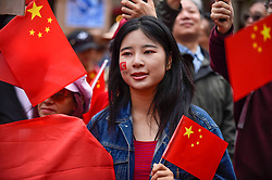 © Licensed to London News Pictures. 18/08/2019. LONDON, UK.  A woman joins members of the capital's Chinese community at a rally in Chinatown to support the people of Hong Kong and China.  They are calling for an end to police violence and a respect for law as protests in the former British colony enter their eleventh week.  Photo credit: Stephen Chung/LNP