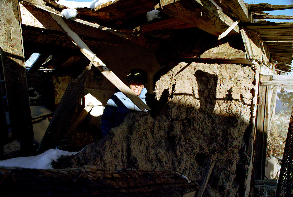 A farmer poses in the sod house he grew up in near Akron in eastern Colorado.