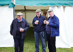 © Licensed to London News Pictures.29/07/15<br /> Borrowby, UK. <br /> <br /> Three men stand outside the beer tent at the Borrowby Country Show and Gymkhana in North Yorkshire.<br /> <br /> Photo credit : Ian Forsyth/LNP