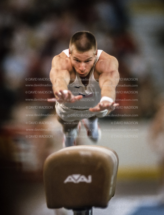 PHOENIX - APRIL 24:  Dan Hayden of the United States competes on the vault during a USA - USSR gymnastics meet on April 24, 1988  at the Arizona Veterans Memorial Coliseum in Phoenix, Arizona.  (Photo by David Madison/Getty Images)