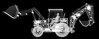 X-ray image of a loader with backhoe (white on black) by Jim Wehtje, specialist in x-ray art and design images.