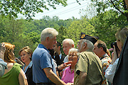 Chappaqua, NY, May 28: Bill and Hillary Clinton shake hands with American War Veterans and other neighbors  after the Memorial Day parade in their hometown of Chappaqua, New York.  Hillary Rodham Clinton was a United States Senator at the time (2006) and was Grand Marshall of the parade.
