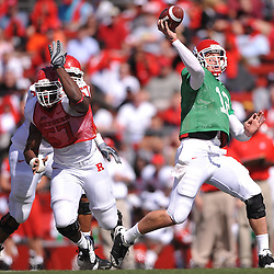Apr 24, 2010; Piscataway, NJ, USA; White quarterback Steve Shimko (12) throws a pass away from pressure by Scarlet defensive end Sorie Bayoh (57) during Rutgers Scarlet and White intersquad NCAA football scrimmage at Rutgers Stadium. The Scarlet squad defeated the White, 16-7.