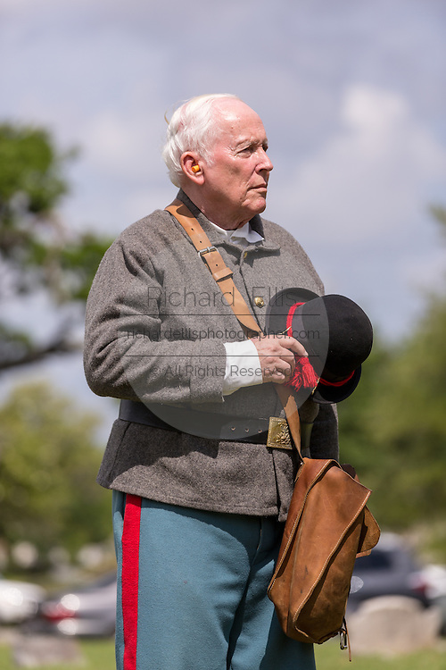 A Civil War re-enactor stands for a moment of silence during Confederate Memorial Day events at Magnolia Cemetery April 10, 2014 in Charleston, SC. Confederate Memorial Day honors the approximately 258,000 Confederate soldiers that died in the American Civil War.