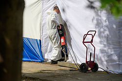 © Licensed to London News Pictures. 16/05/2017. London, UK. Digging equipment being carried in to a forensics tent at the scene where police continue to search for the body of murdered schoolgirl Danielle Jones at a block of garages in Stifford Clays in Thurrock, Essex. The 15-year-old was last seen on Monday June 18 2001 at about 8am when she left her home in East Tilbury to catch the bus to school.  Photo credit: Ben Cawthra/LNP
