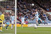 Huddersfield Town defender Mark Hudson (5)  clears the ball during the Sky Bet Championship match between Huddersfield Town and Sheffield Wednesday at the John Smiths Stadium, Huddersfield, England on 2 April 2016. Photo by Simon Davies.