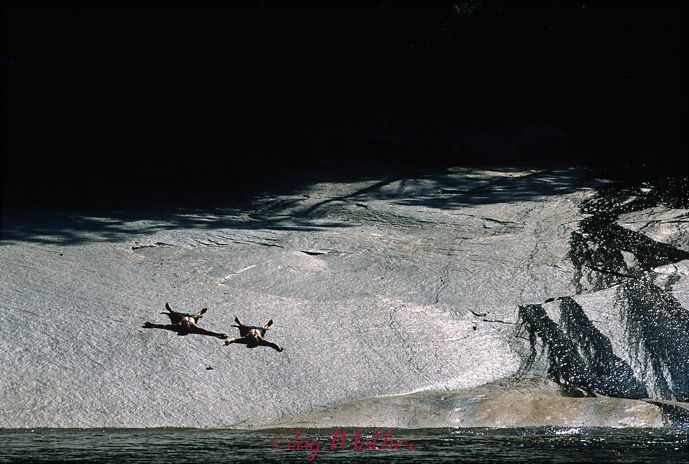 Sunbathers find a unique spot above Vernal Falls called the Silver Apron.  May 1989